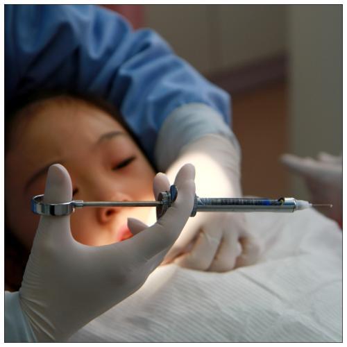 引起牙龈肿痛的原因