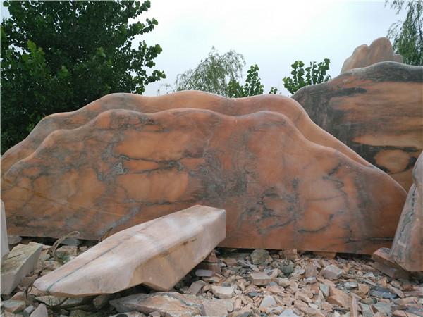 银河石材厂浅谈选择晚霞红景观石的四大理由