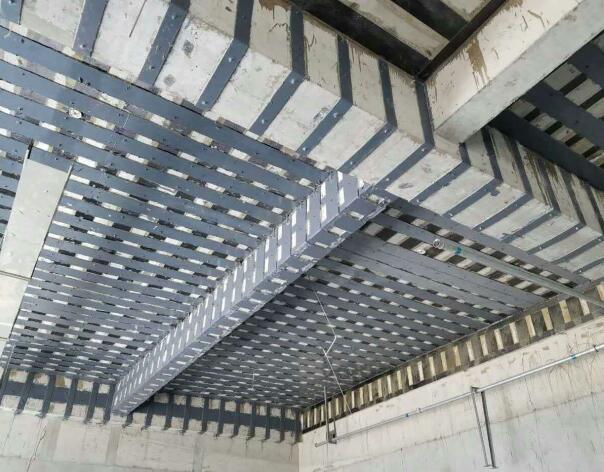 碳纤维布加固在混凝土梁、板、柱的受弯方面作用广泛