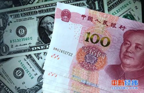 资料图:美元和人民币 中新经纬摄