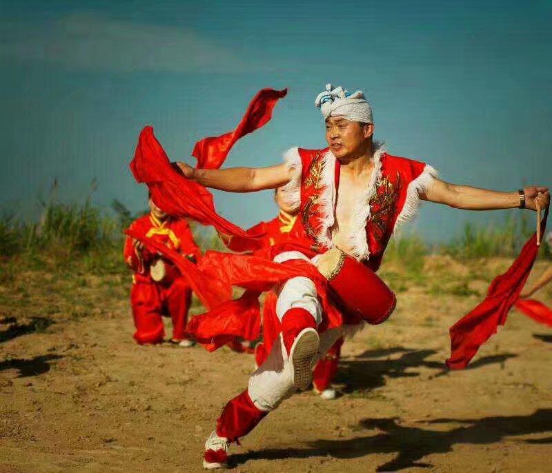 关于陕西安塞腰鼓的风格和艺术特点